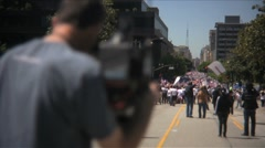 Camera man at Immigration march and rally Stock Footage