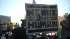 Immigration march and rally - We are human - stock footage