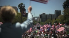 Stock Video Footage of Immigration march and rally - Woman with flag
