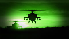 Night Vision of 3 Apache AH-64 Gunship Helicopters Stock Footage