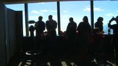 Tourists at window view point Stock Footage