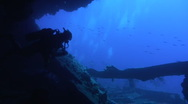 Stock Video Footage of Silhouette of scuba diver inside shipwreck SS Dunraven