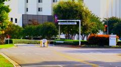 Ambulance leaves hospital Stock Footage