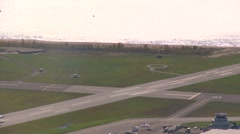Aerial, Dash8 takeoff at airport, through frame, #1 Stock Footage