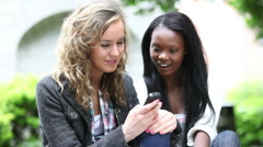 Two Girls Texting on Cell Phone Stock Footage