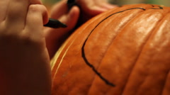 Child Decorating/Carving a Pumpkin # 2 Stock Footage