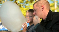 Stock Video Footage of father and son eating cotton candy