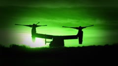 The dual prop V-22 Osprey Military Helicopter in Night Vision - stock footage