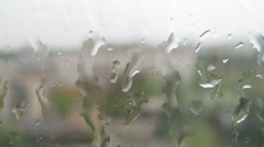 HD Timelapse of water drops on window glass during the rain Stock Footage