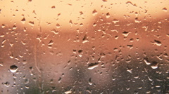 HD rain water drops on the windows glass during sunset Stock Footage