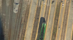 Aerial, time-lapse commuter trains passing Stock Footage