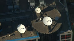 Aerial, rooftop satellite dishes, triangle set Stock Footage