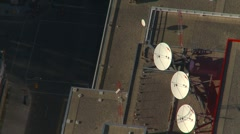 Aerial, rooftop satellite dishes, line set Stock Footage
