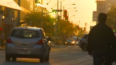 Setting sun with traffic, long lens Stock Footage