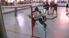fitness, kids playing hockey on plastic ice - stock footage