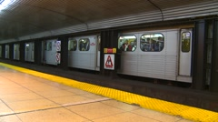 Subway train departing, other tracks with people, Toronto Stock Footage
