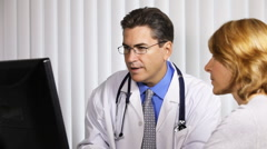 Doctor and woman patient Stock Footage
