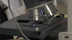 Scientist at Biology Lab Microscope Stock Footage