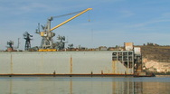 Stock Video Footage of Warship repaired in dock.