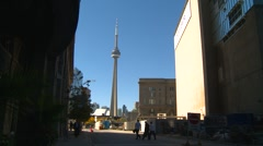 CN tower flanked by buildings Stock Footage