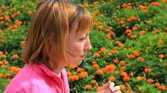 HD Young girl with marigold flower Stock Footage