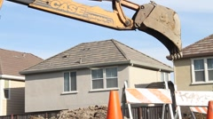 Backhoe at Construction Site Stock Footage