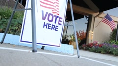 Going to the polls to vote - stock footage