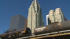 Railroad, tanker freight train with skyline in bg Stock Footage