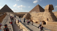Stock Video Footage of Sphinx and Great Pyramid with Tourists