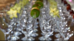 Empty wine glasses with kiwi and carambola moving focus Stock Footage