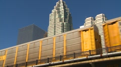Auto carriers freight train with skyline in bg Stock Footage