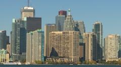 Toronto skyline with Dash8 aircraft through frame medium shot Stock Footage