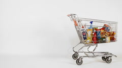 Shopping cart with groceries - stock footage