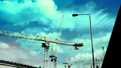Crane munching urban industrial construction building Stock Footage
