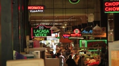 NEON SIGNS IN FOOD COURT Stock Footage