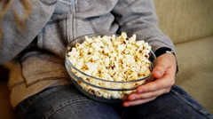 Closeup of child hands eating popcorn Stock Footage