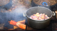 HD Cooking pilaf on a picnic Stock Footage