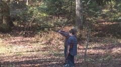 Kids Shooting Shotgun Outdoors Stock Footage