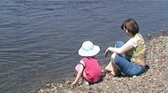 Stock Video Footage of PAL Little girl with mother on the riverside
