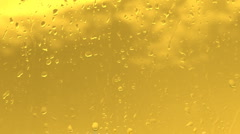 HD rain water drops on the golden surface Stock Footage