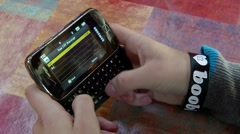 Teen Texting and Sending a Text Message Stock Footage
