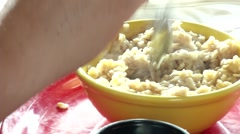 Woman Eating Oatmeal - stock footage