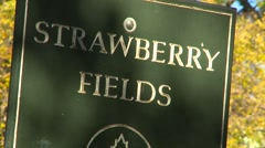 New York City, Strawberry fields sign Central Park, zoom Stock Footage