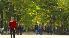 The mall, Central Park, New York City, people on a sunday morning, medium shot Stock Footage