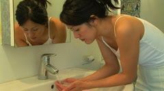 Young woman washing face Stock Footage