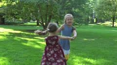 Two girls playing - stock footage