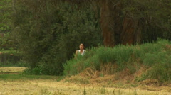 Young woman jogging along rural path Stock Footage