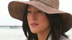 Portrait of young woman on beach in cool weather Stock Footage