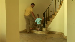 Father and toddler son walking up stairs Stock Footage