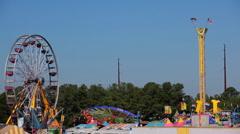 Fun at the Fair - Ferris Wheel and Carousel Stock Footage